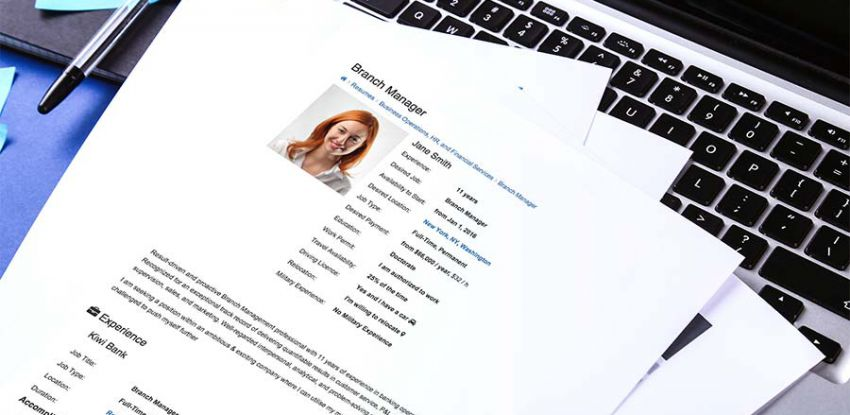 Professional resume sitting on a laptop